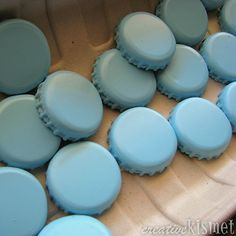 spray paint bottle tops and place magnet on back!  Oh, I see lots of possibilities with these!!