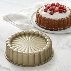 Nordicware Charlotte Cake Pan Nordic Ware Charlotte Cake Pan Durable, heat-responsive cast aluminum promotes even rising, uniform baking and a golden crust. Pound Cake With Strawberries, Strawberry Cakes, Cake Recipes, Dessert Recipes, Desserts, Charlotte Cake, Bundt Cake Pan, Icebox Cake, Nordic Ware