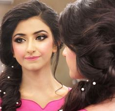 Love her makeup and hairstyle