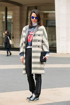 Dial down a pair of tuxedo pants with a cool sweatshirt and sneakers. New York Fashion Week Street Style - Tricks, Tips