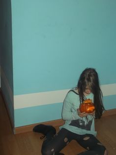 Mereine looking in the middle pumpkin