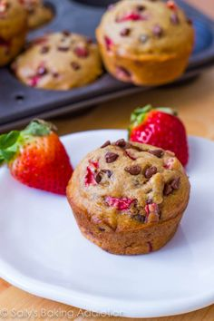 Skinny Strawberry Chocolate Chip Muffins    makes 10 muffins    1 and 1/4 cups all-purpose flour  1/2 teaspoon baking soda  1/2 teaspoon ground cinnamon  1/4 cup granulated sugar  1/4 cup light brown sugar, packed  1/2 cup + 2 Tablespoons unsweetened applesauce  1 egg white, beaten  2/3 cup diced strawberries  1/3 cup mini chocolate chips