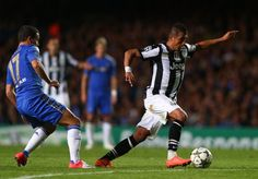 Eden Hazard of Chelsea fails to stop Arturo Vidal of Juventus during the UEFA Champions League Group E match between Chelsea and Juventus at Stamford Bridge on September 19, 2012 in London, England