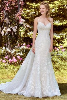 This lace wedding gown from Rebecca Ingram features a sweetheart neckline and detachable train. #weddinggowns