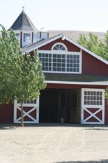 article about planning, budgeting, and financing a barn building project