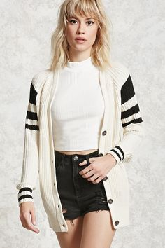 A midweight ribbed knit cardigan featuring a button front, varsity stripes, long sleeves, and two front slanted pockets.