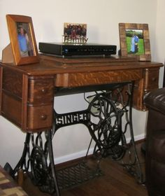 Antique sewing machine used as end table.