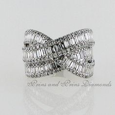 There are 197 = round and baguette cut diamonds pavé and channel set in white gold Dress Rings, Baguette, The Row, Diamond Cuts, Channel, Diamonds, White Gold, Sparkle, Classy