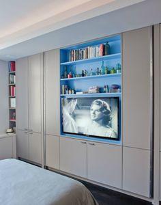 Tv inset between studs plus shallow shelving