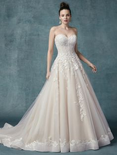 6cfe809babf8 #Zinaida by Maggie Sottero - Floral lace motifs dance over tulle in this  unique princess
