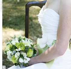 Meghan carried a hand-tied bouquet of green and white flowers, including roses, freesias, orchids, and lisianthuses.