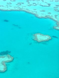 Heart-shaped coral formation in Great Barrier Reef as seen from a helicopter.  Beautiful! Detroit diamond Travel now booking your affordable exotic vacation to this coral reef ! www.DetroitDiamondTravel.com