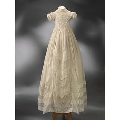 Christening gown. These are boxed and preserved like wedding gowns. Layers of antique lace...