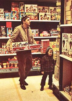A Family Choose Toys In A Woolworths Store In The Late