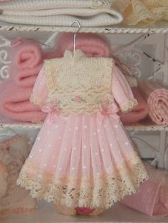 Dollhouse pink girl dress on hang. 1:12 by ANABELAMINIATURES