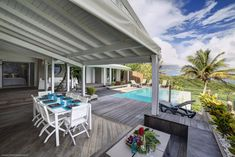 A delightful luxury villa in St Anne, Guadeloupe, french west indies. Discover a beautiful designer villa in a delightful setting in Sainte-Anne, in the middle of the Riviera of Grande-Terre, between Gosier and Saint-François. Villa Caracoli is the best choice for your stay in Guadeloupe, a must for a dream holiday in the Caribbean. Villa Caracoli website is now available in english. Welcome to http://en.villacaracoli.com.