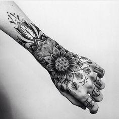 Black and grey wrist tattoo