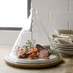 This modern covered cheese server consists of a glass cone-shaped dome that rests upon a base crafted from warm mango wood and cool marble. Kitchen Supplies, Kitchen Items, Kitchen Utensils, Kitchen Gadgets, Kitchen Dining, Kitchen Decor, Kitchen Tools, Vase Deco, Kitchen Essentials