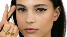 Never been able to master a liner flick? Or a graphic eyeliner look? ELLE's beauty guru make-up artist Lisa Eldridge is here to help with this step-by-step how-to make-up video. Steady hands at the ready...