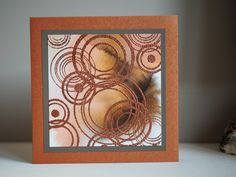 Neutral card, ecoline background, stamp: scrap berry's Circles background stamp, embossing powder copper. By asjechris