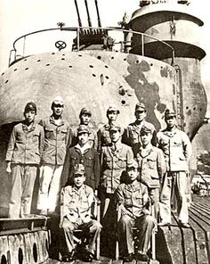 Officers of the Japanese I-400 sub photographed by the US Navy following their surrender at sea, one week after the end of hostilities.