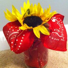 Sunflower barnyard birthday party centerpiece.  See more farm and birthday parties for kids on www.one-stop-party-ideas.com