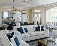 Hello heaven. Blue, white, classic and comfy, with clean lines. In LOVE. The couch, the lights, the light blue in the background and vaulted ceiling!