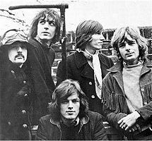 Pink Floyd in January 1968.  From the only known photo shoot of all five members: Nick Mason, Syd Barrett, David Gilmour (seated), Roger Waters and Richard Wright