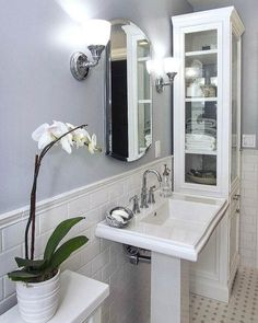 Another angle of the family bathroom, the beautiful bevelled edge mirror is a recessed medicine cabinet, 'Archer', from The tall bathroom cabinet is from Restoration Hardware. Love everything from RH, I wish it was available in the UK. Mirror Cabinets, Bathroom Tall Cabinet, Sink Faucets, Heated Bathroom Mirror, Medicine Cabinet Mirror, Bathroom Mirror Cabinet, Bathroom Design, Bathroom Decor, Bathroom Cabinets Uk