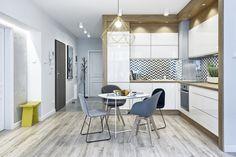 Kuchnia wraz z jadalnią należy do pokoju dziennego. Oryginalny żyrandol lampy nad stołem jadalnianym kolorem spójnie spójnie nawiązuje do drobnych mebli z części salonowej.