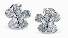 The striking floral design of these Simon G.  earrings is accented by .40 pear-cut diamonds .84 pear-shaped diamonds and .94 marquise cut ctw diamonds to create an unforgettable look. | Peter Franklin Jewelers