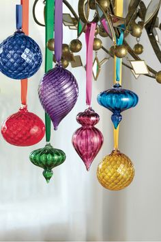 Hanging ornaments from a light fixture or chandelier can add a festive touch -- whether in the dining room over the holiday table, or in the living room amidst your Christmas party celebrations. Ornaments can be wonderful decorations, even off the tree!