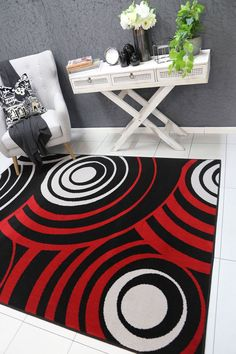 Runiullae Modern Cir Red Black Rug A marvelous exhibit of trendsetting rugs, this Collection instills life into extraordinary spaces. Expertly power-loomed in Turkey, these rugs are easy-care and virtually non-shedding. Classic designs become fashion-smart home decor in this alluring and playful collection.