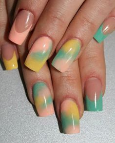 I like the way she sponged the 3 colors together on some nails and did the french with those same 3 colors on different nails. Me gusta!!