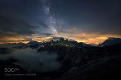 "Dreamscape  Just back from time-lapse shooting at one of my favorite places in the Dolomites. The ""Godzilla Mountain"" (2340m altitude) It was cold unstable fucking expensive and absolutely amazing!  One cool side effect of time-lapse is that I can stack several shots for the sky and the foreground to reduce noise. I'm very pleased with the result I even think this is the best night shot I've ever did because it has everything I like (and most astrophotographers don't). Cool light-pollution…"