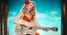 """Kylie Minogue channels Dolly Parton and the Day of the Dead in the vibrant new video for her song, """"Dancing."""""""