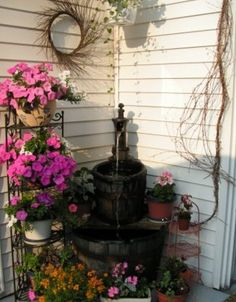 Fountain my hubby made for me-out of whiskey barrel and an old pump. Whiskey Barrel Fountain, Goldfish Pond, Bee Keeping, Water Features, Fountain Ideas, Backyard, Outdoor Structures, Orchards, Rustic