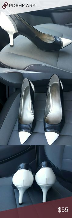Super classy black and white pumps Gorgeous black and white pumps. Completely new soles and heels. Like new, see photos!  The toe tip is white with a clear band going across.  Super smart and elegant.  You will get tons of compliments on these!! Bandolino Shoes Heels