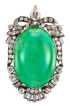 Cabochon Emerald and Diamond Pendant-Brooch. Silver, gold, one oval cabochon emerald ap. 80.00 cts., one old-mine pear-shaped diamond ap. .50 ct., 40 old-mine cut & round & 11 baguette diamonds ap. 2.95 cts. Probably late 19th to early 20th century.