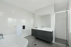 Spacious, clean, sophisticated, cool colours, what a show stopper. Built by Dixon Homes Cairns