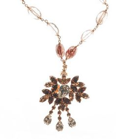 """Circa 1930, Austrian Crystal Medallion on Rudilated Quartz Crystal on gold wire chain. Necklace length 16 1/2"""" inches. Pendent length 2 1/2"""" inch. Pendent width 2"""" inch. Toggle clasp. Made in USA.  www.thesagelifestyle.com"""