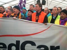 Employees at NedCar protesting to keep  their jobs. Concerned faces. Most sad, some angry. After years of uncertainty I'm afraid they're on the losing hand.