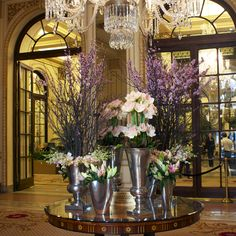 This eye catching arrangement in The Plaza Hotel Lobby is designed with scaling lush plum blossoms, vibrant pink Amaryllis', fresh hybrid lilies and pale pink Dendrobium orchids. The stunning display composed of vivid hues of pinks perfectly captures the beginning of spring and sunny days ahead. #theplazahotel