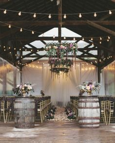 High Star Ranch has an open-side barn that the couple loved for the dancing portion of the evening. To make the venue a bit more formal, Sara and Matt incorporated gold touches and chandeliers into the décor. Flowing fabrics and draping floral arrangements in taupe, lilac, deep plum, and peach also softened the barn.