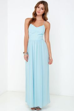 From a rooftop gala to a breezy balcony, the Rooftop Icing Light Blue Maxi Dress deserves a grand occasion! Light blue chiffon shapes adjustable spaghetti straps atop a triangle bodice with flattering princess seams and side cutouts. The modified racerback has a button closure, keyhole opening, and a hidden zipper. Long, flowing skirt extends from a lightly gathered, fitted waist. Fully lined. Self: 100% Polyester. Lining: 98% Polyester, 2% Spandex. Dry Clean Only.