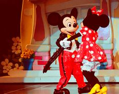 Mickey & Minnie putting on a very sweet show.