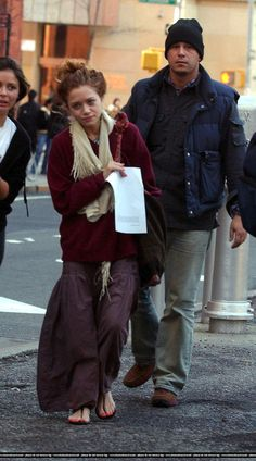 "For those of you not paying attention in 2005/2006, Mary Kate started  rocking the homeless chic look, otherwise known as ""Effortless Cali"" and  every fashion girl became obsessed with her. She just has this incredible  talent for layering! I love that she even made flip flops look cool... what  an inspiration."