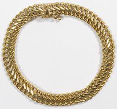 Lot 210: 14k Gold Chain Bracelet; Having a double twisted link