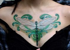 Dragonfly chest tattoo