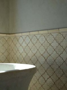 Elegant Moroccan shape bathroom wall tiles with a neutral color pattern.